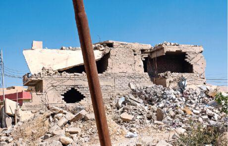Zerstörte Häuser in der Ninive-Ebene